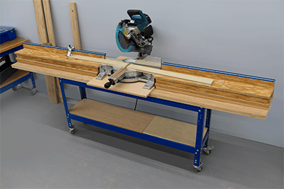 A miter saw station set up with support wings for long boards