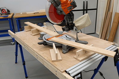 A miter saw with outfeed support for crosscutting long boards