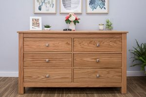 classic wood dresser with drawers in a bedroom