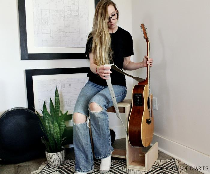 shara-picking-guitar-out-of-stool-stand-small