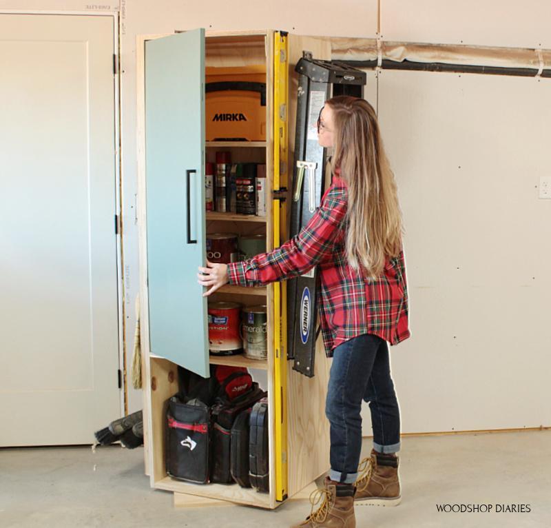 shara-opening-door-of-garage-storage-cabinet-small