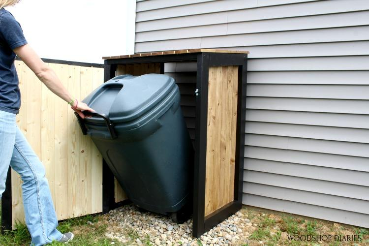 shara-pulling-trash-can-out-of-cover-small