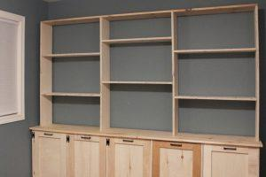 Shelving Unit with Storage and Tilt-Out Laundry